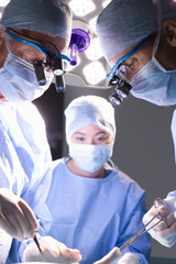 Concentrating surgeons performing operation in operating room