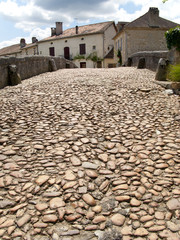 Cobblestone bridge in St Jean de Cole, Dordogne, France