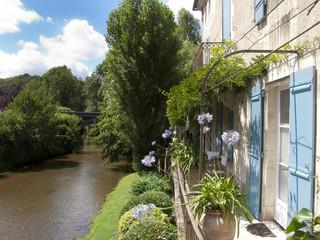 Buildings next to river in St Jean de Cole, Dordogne, France