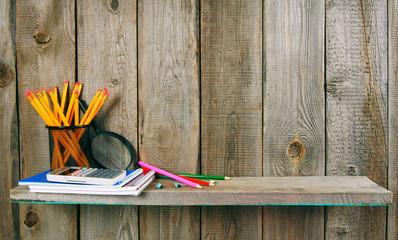 School accessories. On wooden background.