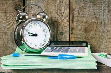 Alarm clock and school accessories.
