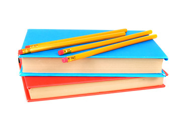 Books and pencils. On white background.
