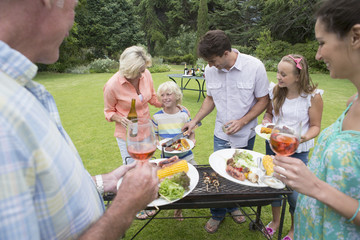 Multi-generation family serving barbecue