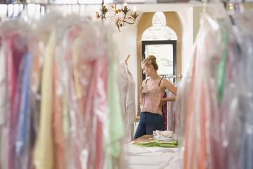 Fashion Designer Relaxing In Design Studio