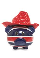 british piggy bank wearing cowboy hat