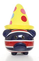 piggy bank wearing clown hat