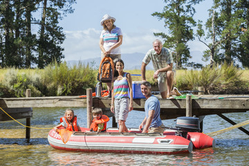 Multi-Generation Family Enjoying Boat Trip On Lake