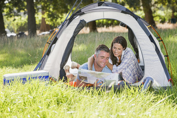 Couple Enjoying Camping Holiday In Countryside