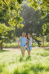 Romantic Couple Walking In Beautiful Countryside