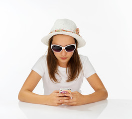 Fashionable yong girl sending an sms