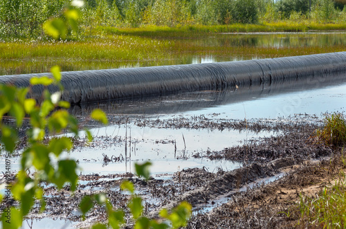 Spilled oil around the oil pipeline - 69341075