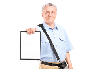 Mature mailman holding a clipboard