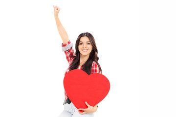 Overjoyed woman holding a big red heart