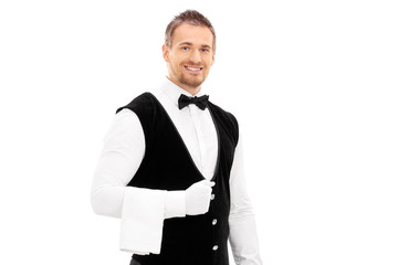 Professional waiter with a towel around his arm