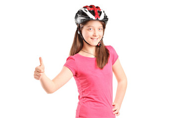 Satisfied girl with a helmet on roller skates