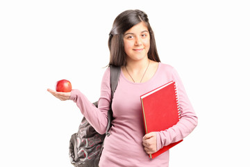 Schoolgirl holding an apple
