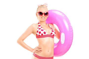 Sexy woman in bikini holding a swimming ring