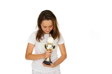 Young girl clasping a sporting trophy