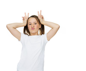 Young girl making a horns gesture