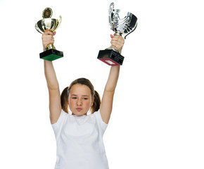 Young female champion raising trophy