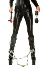 Woman in latex suit holding with handcuffs