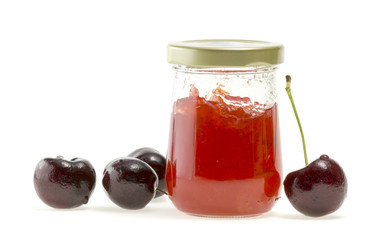 Jam in bottle and nectarines on white background.
