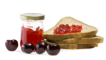 Jam in bottle,bread and nectarines on white background.