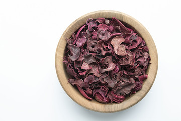 Wooden pot with dry flowers