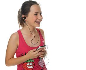 Happy young girl enjoying her music