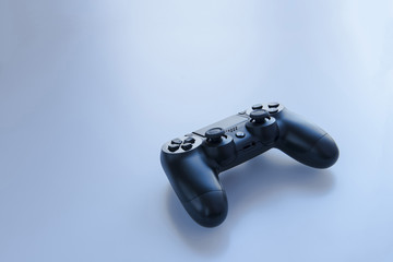 game controller on a blue-gray background