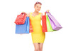 Trendy woman holding a bunch of shopping bags