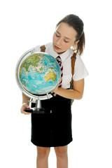 Young schoolgirl examining a world globe