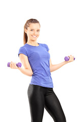 Woman in sportswear holding two dumbbells