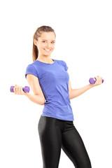 Woman in sportswear holding two dumbbells