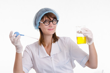 Chemist with a pipette and bulb