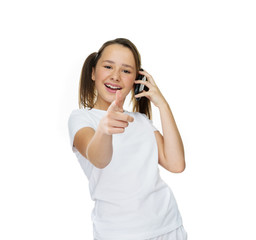 Laughing young girl giving a thumbs up gesture