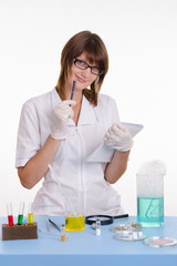 Pharmacist with a notebook in the lab