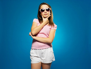 Thoughtful trendy young girl in sunglasses