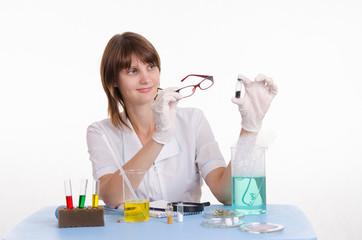 chemist examines powder