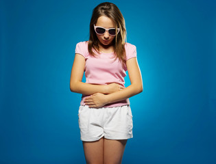 Young girl with a stomach ache