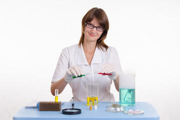 Pharmacist mixes the two liquids