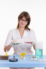 Chemist mixes the two liquids
