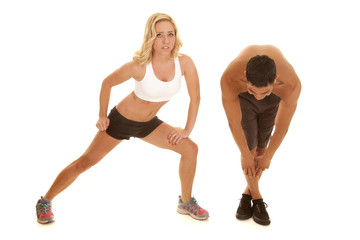 couple stretch together her lunge