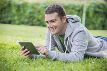 young man internet tablet