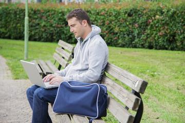 young man laptop