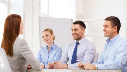 smiling businesswoman at interview in office