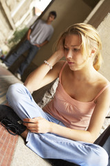 A teenage girl looking distressed.