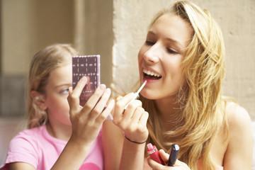 A girl applying make up.