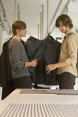 Men looking at clothes at a boutique.