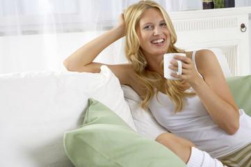 A woman drinking tea.